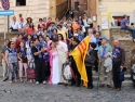 Newly wed couple surprises to see a whole group of Vietnamese pilgrims at St. Peter's square.